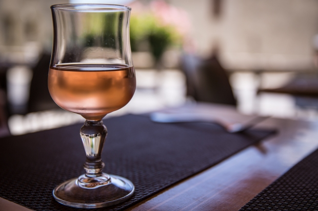 A glass of local rosé, perfectly paired with pizza